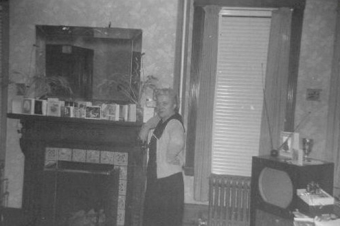 034-nana-by-fireplace-in-front-room-1961
